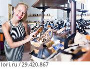 Купить «girl choosing pair of shoes in store», фото № 29420867, снято 9 декабря 2018 г. (c) Яков Филимонов / Фотобанк Лори