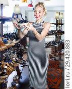 Купить «Glad woman shopping pair of new shoes», фото № 29420883, снято 9 декабря 2018 г. (c) Яков Филимонов / Фотобанк Лори