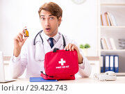 Купить «Young doctor with first aid kit in hospital», фото № 29422743, снято 23 августа 2018 г. (c) Elnur / Фотобанк Лори