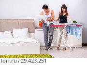 Купить «Young woman doing ironing for her husband», фото № 29423251, снято 27 июня 2018 г. (c) Elnur / Фотобанк Лори