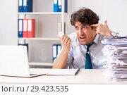 Купить «Overloaded busy employee with too much work and paperwork», фото № 29423535, снято 3 июля 2018 г. (c) Elnur / Фотобанк Лори