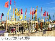 Купить «Fishermen's floats and flags on the beach at Monte Gordo, Algarve, Portugal.», фото № 29424399, снято 6 октября 2018 г. (c) age Fotostock / Фотобанк Лори