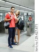 Купить «Man with his girlfriend are standing near turnstiles», фото № 29427871, снято 14 июня 2018 г. (c) Яков Филимонов / Фотобанк Лори