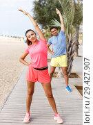 Купить «Couple training outdoors», фото № 29427907, снято 26 июня 2018 г. (c) Яков Филимонов / Фотобанк Лори