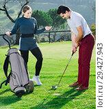 Купить «Man golfer concentrating to kick the bal», фото № 29427943, снято 23 марта 2019 г. (c) Яков Филимонов / Фотобанк Лори