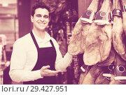 Купить «Seller in delicatessen section», фото № 29427951, снято 19 апреля 2019 г. (c) Яков Филимонов / Фотобанк Лори