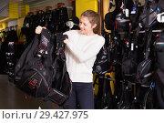 Купить «Sporty woman is satisfied of new diving vest in the diving store.», фото № 29427975, снято 25 января 2018 г. (c) Яков Филимонов / Фотобанк Лори