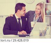 Купить «Adult business couple flirting in office», фото № 29428019, снято 20 апреля 2017 г. (c) Яков Филимонов / Фотобанк Лори
