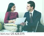 Купить «Banking agent with nice offer consulting customer at home», фото № 29428075, снято 18 сентября 2019 г. (c) Яков Филимонов / Фотобанк Лори
