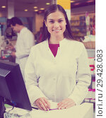 Купить «pharmaceutists at reception of drugstore ready to help», фото № 29428083, снято 19 апреля 2019 г. (c) Яков Филимонов / Фотобанк Лори