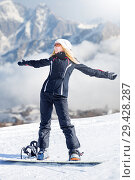 Купить «Young adult woman snowboarder holding snow board», фото № 29428287, снято 18 марта 2018 г. (c) katalinks / Фотобанк Лори