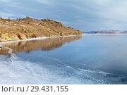 Купить «Lake Baikal in December. Coastal rocks are reflected in thin blue transparent ice on a sunny frosty day», фото № 29431155, снято 2 декабря 2012 г. (c) Виктория Катьянова / Фотобанк Лори