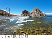 Купить «Baikal Lake on a sunny May day. Beautiful spring landscape with melting ice in the bay near the famous Shamanka Rock on the Olkhon Island», фото № 29431175, снято 22 мая 2011 г. (c) Виктория Катьянова / Фотобанк Лори