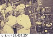 Купить «Women selling fine chocolates», фото № 29431251, снято 26 июня 2019 г. (c) Яков Филимонов / Фотобанк Лори