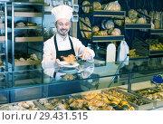Купить «Experienced male pastry maker demonstrating croissant», фото № 29431515, снято 26 января 2017 г. (c) Яков Филимонов / Фотобанк Лори