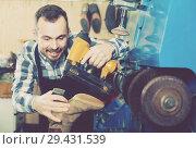 Купить «male worker fixing failed shoes in shoe repair workshop», фото № 29431539, снято 2 февраля 2017 г. (c) Яков Филимонов / Фотобанк Лори