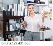 Купить «Young woman take a choise bottle for liquid soap in supermarket», фото № 29431655, снято 2 мая 2018 г. (c) Яков Филимонов / Фотобанк Лори