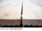 Купить «Укладка деревянной террасной доски», фото № 29434827, снято 20 июня 2018 г. (c) Вячеслав Палес / Фотобанк Лори