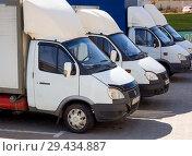 Купить «Грузовые машины переоборудованные на газ стоят на парковке», фото № 29434887, снято 23 июня 2018 г. (c) Вячеслав Палес / Фотобанк Лори
