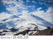 Купить «The western and eastern peaks of Elbrus closeup», фото № 29435235, снято 8 июля 2015 г. (c) katalinks / Фотобанк Лори
