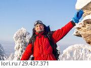 Купить «Traveler man with backpack in winter landscape waving his hand in greeting and smiling», фото № 29437371, снято 11 декабря 2017 г. (c) Евгений Харитонов / Фотобанк Лори