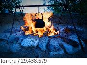 Купить «Boiling kettle hanging over the fire.», фото № 29438579, снято 28 июля 2017 г. (c) Акиньшин Владимир / Фотобанк Лори