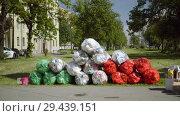 Купить «Mobile receiving point of waste recycling. environmental movement RAZdelniy sbor», видеоролик № 29439151, снято 2 июня 2018 г. (c) Ирина Мойсеева / Фотобанк Лори
