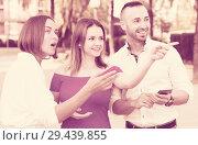 Купить «Stranger man is asking about way from young females who are walking», фото № 29439855, снято 18 октября 2017 г. (c) Яков Филимонов / Фотобанк Лори
