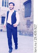 Купить «Man in formalwear walking along street», фото № 29439927, снято 5 августа 2017 г. (c) Яков Филимонов / Фотобанк Лори