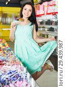 sexy cheerful female posing in the store with lolly. Стоковое фото, фотограф Яков Филимонов / Фотобанк Лори