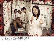 Купить «Happy girls in quest room with bloody traces», фото № 29440047, снято 8 октября 2018 г. (c) Яков Филимонов / Фотобанк Лори