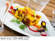 Купить «Raw tuna tartare with mango and avocado», фото № 29440227, снято 19 декабря 2018 г. (c) Яков Филимонов / Фотобанк Лори