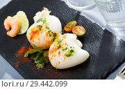 Купить «Roasted sepia served with shrimps», фото № 29442099, снято 18 января 2019 г. (c) Яков Филимонов / Фотобанк Лори