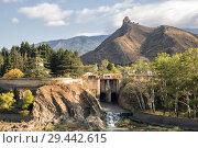 Купить «Jvari Monastery high on mountain above dam on Kura River, Georgia, Mtskheta», фото № 29442615, снято 24 сентября 2018 г. (c) Юлия Бабкина / Фотобанк Лори