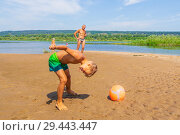 Купить «Little handsome boy plays with his head a soccer ball on a sandy beach on a summer sunny day.», фото № 29443447, снято 26 июля 2018 г. (c) Акиньшин Владимир / Фотобанк Лори