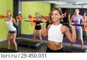 Купить «Group of athletic young females exercising with barbell», фото № 29450031, снято 26 июля 2017 г. (c) Яков Филимонов / Фотобанк Лори