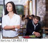 Купить «quarreled visitors female and male in restaurant», фото № 29450115, снято 11 декабря 2017 г. (c) Яков Филимонов / Фотобанк Лори
