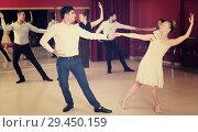 Купить «People practicing vigorous lindy hop movements», фото № 29450159, снято 24 мая 2017 г. (c) Яков Филимонов / Фотобанк Лори