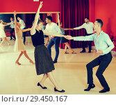 Купить «People practicing lindy hop movements», фото № 29450167, снято 24 мая 2017 г. (c) Яков Филимонов / Фотобанк Лори