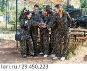 Купить «Cheerful team of players wearing camouflage», фото № 29450223, снято 11 августа 2018 г. (c) Яков Филимонов / Фотобанк Лори