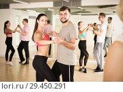 Купить «couples enjoying of partner dance», фото № 29450291, снято 9 октября 2017 г. (c) Яков Филимонов / Фотобанк Лори