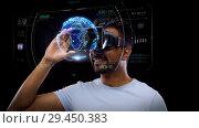 Купить «man in vr headset with virtual earth projection», видеоролик № 29450383, снято 22 мая 2019 г. (c) Syda Productions / Фотобанк Лори