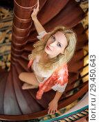 Купить «girl in silk robe stand on wooden spiral staircase», фото № 29450643, снято 26 апреля 2017 г. (c) katalinks / Фотобанк Лори