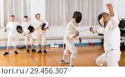 Купить «Two fencing instructors showing effective techniques», фото № 29456307, снято 30 мая 2018 г. (c) Яков Филимонов / Фотобанк Лори