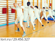 Купить «Adult and boys fencers practicing fencing technique», фото № 29456327, снято 30 мая 2018 г. (c) Яков Филимонов / Фотобанк Лори