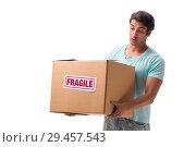 Купить «Young handsome man with fragile box ordered from Internet», фото № 29457543, снято 6 июля 2018 г. (c) Elnur / Фотобанк Лори