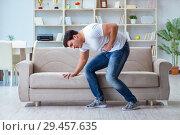 Купить «Sick man suffering at home from infection and bad stomach», фото № 29457635, снято 5 апреля 2017 г. (c) Elnur / Фотобанк Лори