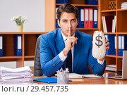 Купить «Young employee working in the office», фото № 29457735, снято 9 августа 2018 г. (c) Elnur / Фотобанк Лори