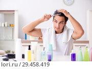 Купить «Young handsome man in the bathroom in hygiene concept», фото № 29458419, снято 19 июля 2018 г. (c) Elnur / Фотобанк Лори