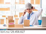 Купить «Male employee working in box delivery relocation service», фото № 29458827, снято 24 июля 2018 г. (c) Elnur / Фотобанк Лори